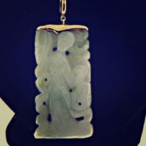 18k gold and jade carved pendant